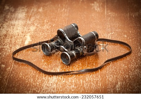 Old military binoculars, retro style - stock photo