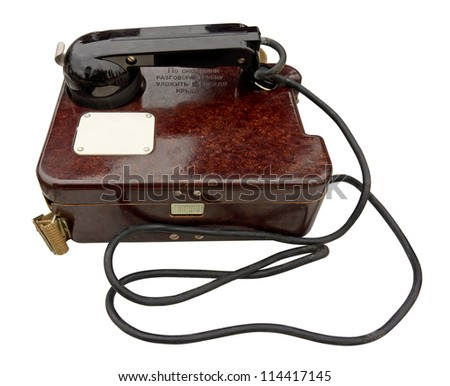 Old military field telephone isolated on white. Clipping path included. - stock photo