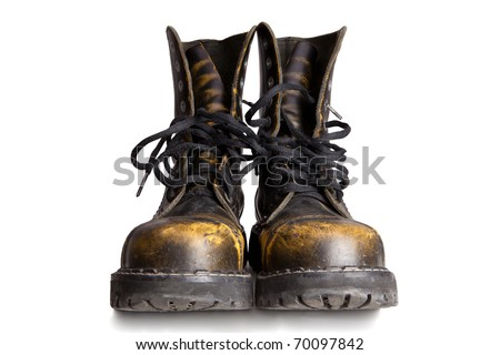 Old military style boots isolated on white background - stock photo
