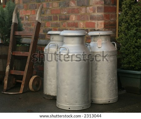 old milk churns - stock photo