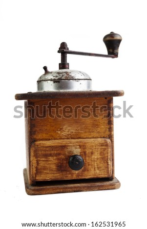 Old mill for grinding coffee beans on white background