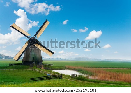Old mill in Netherlands near Molendjik - stock photo