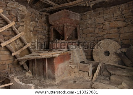 Old mill interior - abandoned ruins - stock photo