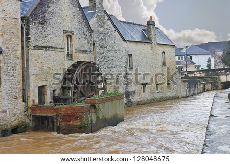 Old mill on river in the town of Bayeux. Normandy, France - stock photo