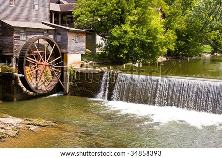 old mill water wheel in pigeon forge tennessee - stock photo