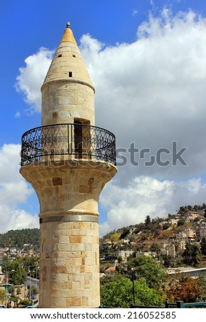 old minaret in Safed on the background of a residential area on Mount Canaan, Israel - stock photo