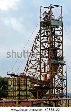 Old Mine Winding Gear at a Gold Mine near Johannesburg - stock photo