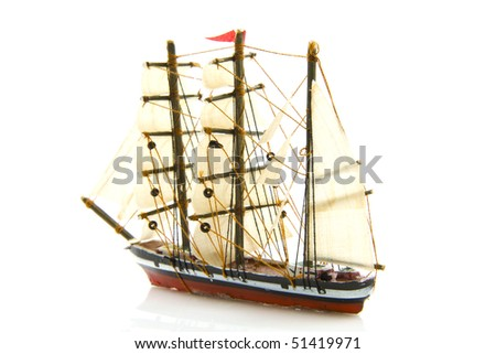 Old miniature boat isolated on a white background