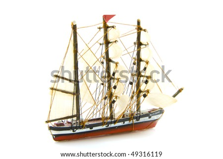 Old miniature sail boat isolated over white - stock photo