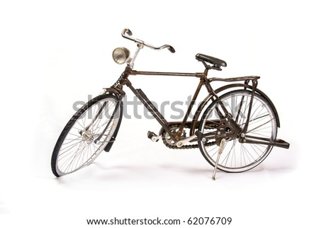 Old miniature vintage bicycle isolated on a white background - stock photo
