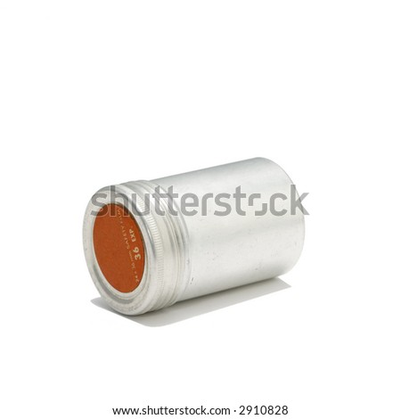 old 35 mm film container in metal (white background) - stock photo