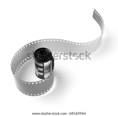 Old 35 mm film in cartridge on a white background. - stock photo