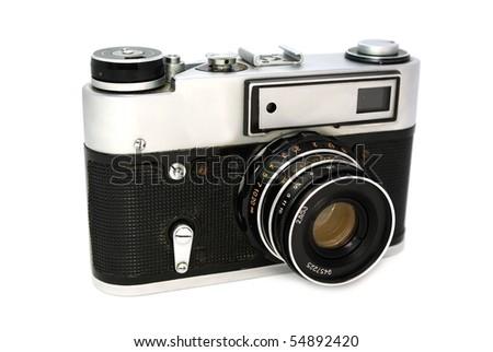 Old 35mm film photo camera on white background - stock photo