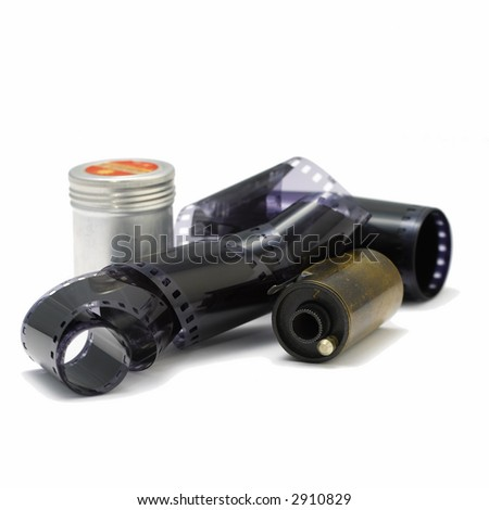 old 35 mm film strip with  a metal container and an old cartridge(white background) - stock photo