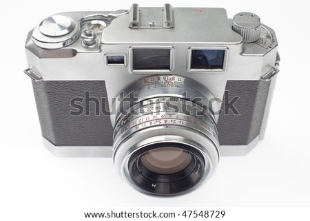 old 35mm rangefinder camera, top view, on a white background. - stock photo