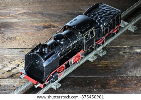 old model railway on wooden background - stock photo