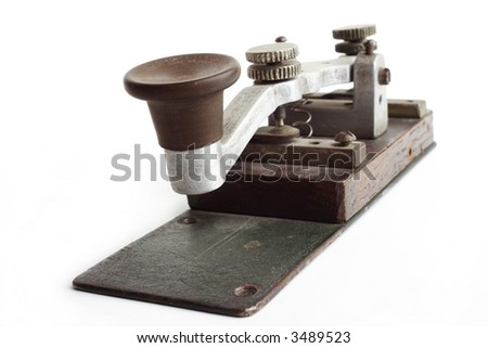 Old morse key on white background - stock photo
