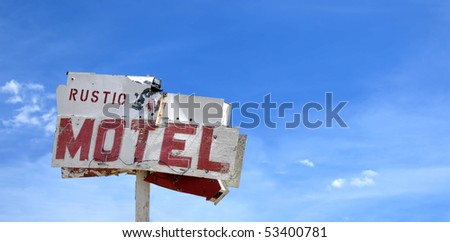 Old motel sign in California's Mojave Desert. - stock photo