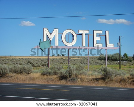 old motel sign in desert - stock photo