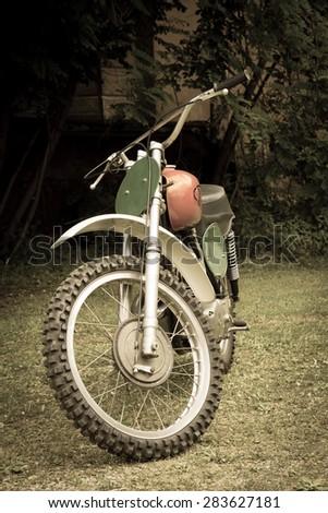 Old motocross bike - stock photo