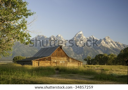 Old Moulton Mormon barn in Wyoming near the Tetons at sunrise - stock photo