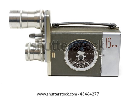 Old movie camera 16 mm with two lenses on white background - stock photo