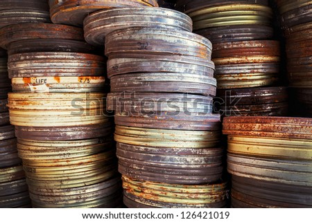 Old movie film canisters, abandoned  and rusty - stock photo