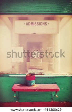 Old Movie theater entrance, focus on center intercom - stock photo