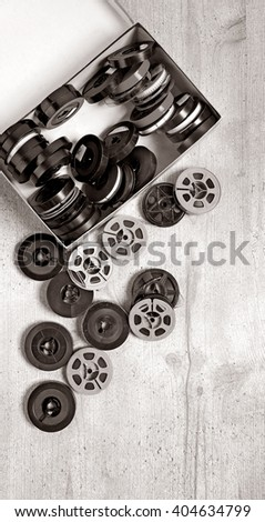 Old movies on wooden background (with space for your logo or text) - stock photo
