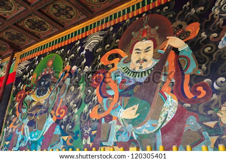 old mural painting on ancient buddhist temple wall in inner mongolia,China.buddhist four heavenly kings - stock photo