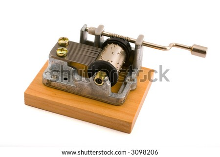 old music box on wooden base isolated on white