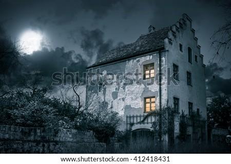 Old mystic villa in moonlight - stock photo