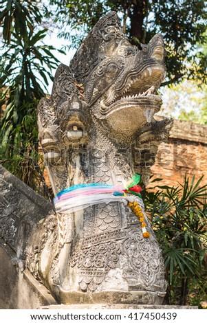 Old naga statue in Wat Umong, Chiangmai Thailand - stock photo