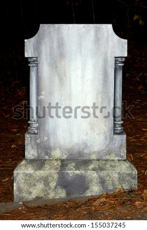 old nameless tombstone in cemetery setting - stock photo