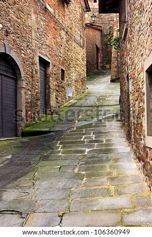 old narrow alley in tuscan village - antique italian lane in Tuscany, Italy - stock photo