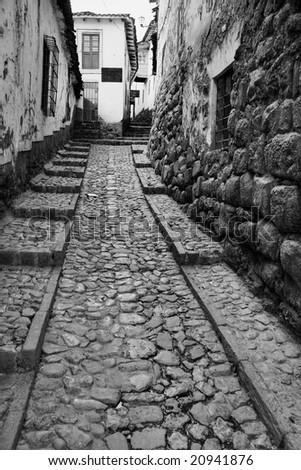 Old narrow street in Cusco - stock photo