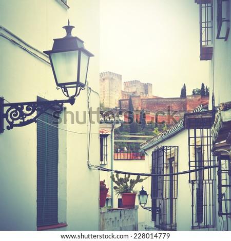 Old narrow street in Granada, Spain.Instagram style filtred image - stock photo