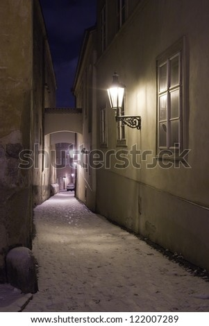 Old Narrow Street In the Winter and Night. Prague, Czech Republic - stock photo