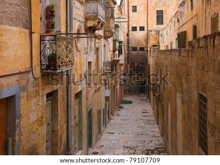 Old narrow  street of european town (Valletta, Malta) - stock photo