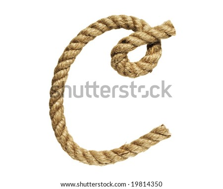 old natural fiber rope bent in the form of letter C - stock photo