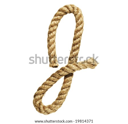 old natural fiber rope bent in the form of letter J - stock photo