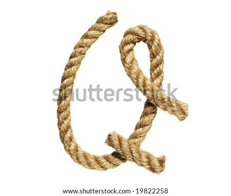 old natural fiber rope bent in the form of letter Q - stock photo