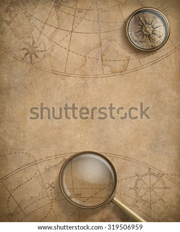 old nautical map with compass and loupe - stock photo