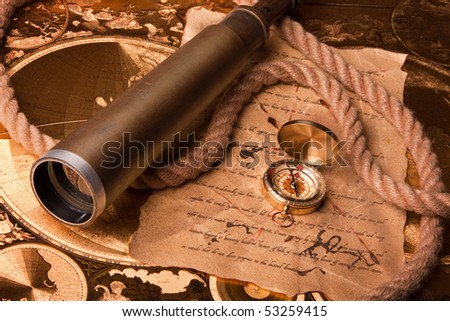 Old navigation instrument, map compass and lunette - stock photo