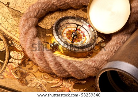 Old navigation instrument, map compass and rope