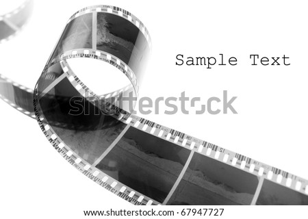Old negative film strip with easy removable text. - stock photo