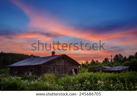 old neglected house in the blossoming opening at the end of the day - stock photo