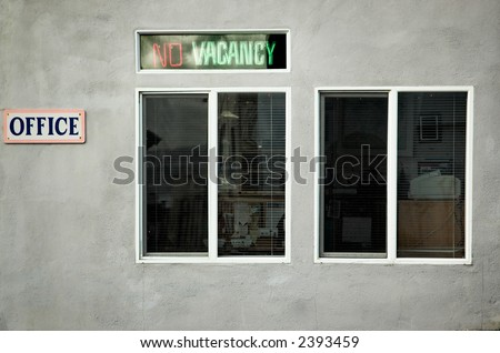 """Old neon """"No Vacancy"""" sign outside a motel office - stock photo"""