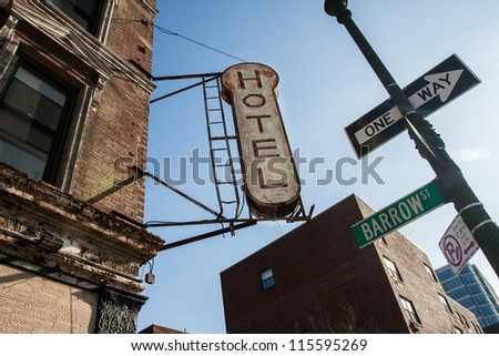 Old neon on Hotel. Barrow St. One Way entrance. - stock photo