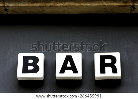 Old Neon Sign Of a Bar. - stock photo